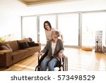 disabled senior woman in... | Shutterstock . vector #573498529