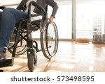 unrecognizable disabled senior... | Shutterstock . vector #573498595