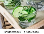 glasses with detox infused... | Shutterstock . vector #573505351
