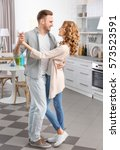 cute young couple dancing at... | Shutterstock . vector #573523591