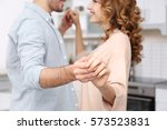 cute young couple dancing at... | Shutterstock . vector #573523831