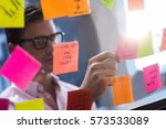 Hipster Reading A Post It On A...