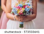 Bride With Flowers In Hand...