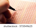 fill out a bingo lotto lottery... | Shutterstock . vector #573549625