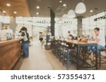 abstract blur coffee shop cafe... | Shutterstock . vector #573554371