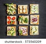fruit vegetables sandwiches on... | Shutterstock . vector #573560209