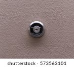 Small photo of Peep Hole on Tan Painted Door centered