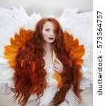 red haired angel | Shutterstock . vector #573564757