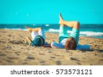 father and son relax on the... | Shutterstock . vector #573573121