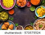 assorted indian food on dark... | Shutterstock . vector #573575524