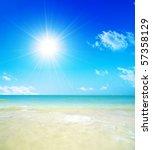 tropical beach  sunny blue sky | Shutterstock . vector #57358129
