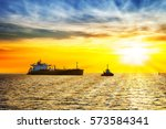 sun setting at the sea with... | Shutterstock . vector #573584341