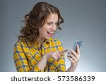 beautiful young woman in a... | Shutterstock . vector #573586339