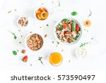 breakfast with muesli ... | Shutterstock . vector #573590497