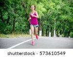 young woman running | Shutterstock . vector #573610549