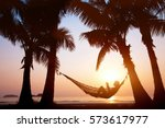 woman relaxing in hammock on... | Shutterstock . vector #573617977