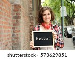 young beautiful woman holding... | Shutterstock . vector #573629851