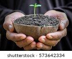 two hands of the men was...   Shutterstock . vector #573642334