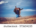 young successful woman jump on... | Shutterstock . vector #573654235