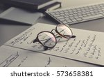 vintage glasses  notebook and... | Shutterstock . vector #573658381