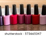 group of bright nail polishes... | Shutterstock . vector #573665347