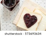 toast with jam in shape of... | Shutterstock . vector #573693634