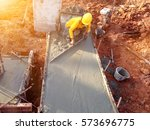 man hand spreading concrete mix ... | Shutterstock . vector #573696775