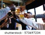 hands hold beverage beers... | Shutterstock . vector #573697234