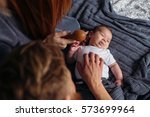 young parents giving lots of... | Shutterstock . vector #573699964