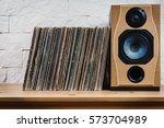 wooden shelf full of old vinyl... | Shutterstock . vector #573704989
