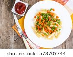 rigatoni pasta with vegetables... | Shutterstock . vector #573709744