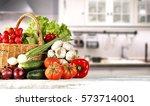 Vegetables In Kitchen On White...