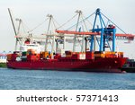 Large container ship being unloaded in Hamburg Dock - stock photo