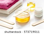 wax for depilation on white... | Shutterstock . vector #573719011