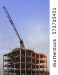 a crane and scaffolding during... | Shutterstock . vector #573735451