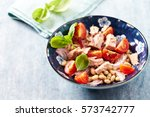 tuna salad with cherry tomatoes ... | Shutterstock . vector #573742777