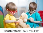 kids playing doctor and curing... | Shutterstock . vector #573743149