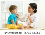 female doctor examining kid... | Shutterstock . vector #573743161