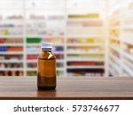 pill bottle on table top on... | Shutterstock . vector #573746677
