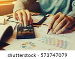 businessman calculate finance... | Shutterstock . vector #573747079
