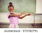 Schoolgirl Playing Flute In...