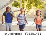 happy school kids running in... | Shutterstock . vector #573801481
