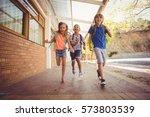 happy school kids running in... | Shutterstock . vector #573803539