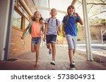 happy school kids running in... | Shutterstock . vector #573804931