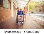 happy school kids pushing a boy ... | Shutterstock . vector #573808189