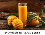 fresh tropical fruit smoothie... | Shutterstock . vector #573811555