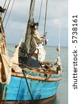 a well used fishing boat rests... | Shutterstock . vector #5738161