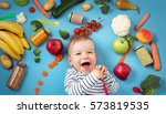 baby surrounded with fruits and ... | Shutterstock . vector #573819535