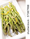 Asparagus with lemon sauce and pine nuts - stock photo