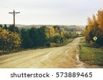 rural dirt road landscape with... | Shutterstock . vector #573889465